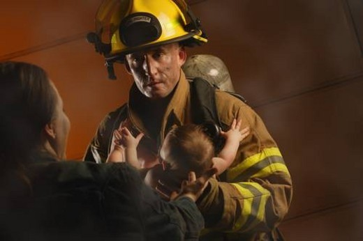 Stock Photo: 4029R-373822 Fireman rescues baby