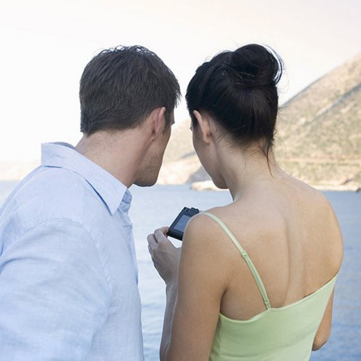 Stock Photo: 4029R-373998 A couple taking holiday photos