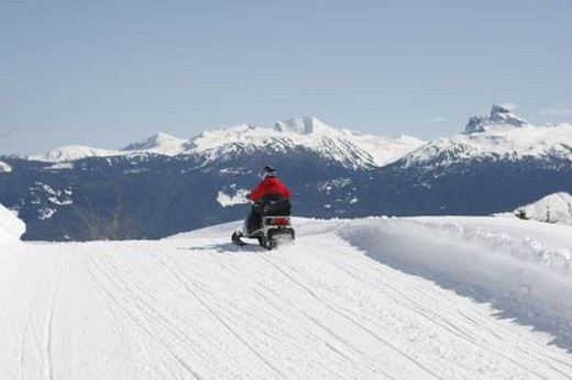 Stock Photo: 4029R-374545 snowmobile adventure tour in Whistler British Columbia