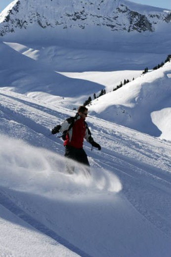 Stock Photo: 4029R-374922 Back country skiing and snowboarding during cat ski and heli ski trips in the Whistler, British Columbia area.