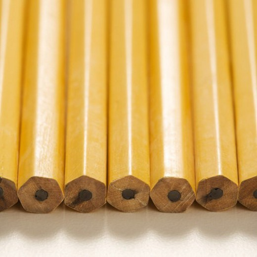 Stock Photo: 4029R-375316 Close up of group of new unsharpened pencils lined up in an even row.