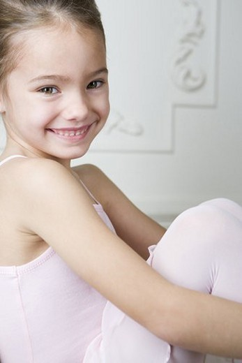 Portrait of a smiling girl in a ballet tutu : Stock Photo