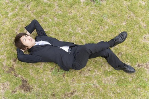 Stock Photo: 4029R-378158 Businessman Lying On Grass