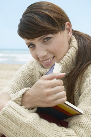 Mid-Adult Woman with Book on Beach : Stock Photo