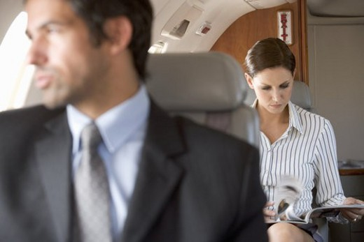 Passengers relaxing on a flight : Stock Photo