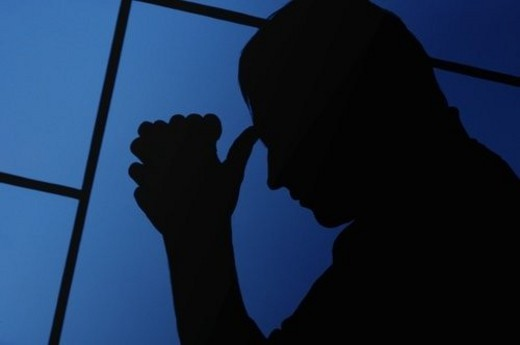 Silhouette of a man praying : Stock Photo