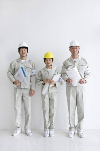 Stock Photo: 4029R-386104 Construction workers holding blueprints and documents