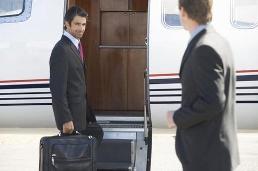 A businessman boarding a plane : Stock Photo