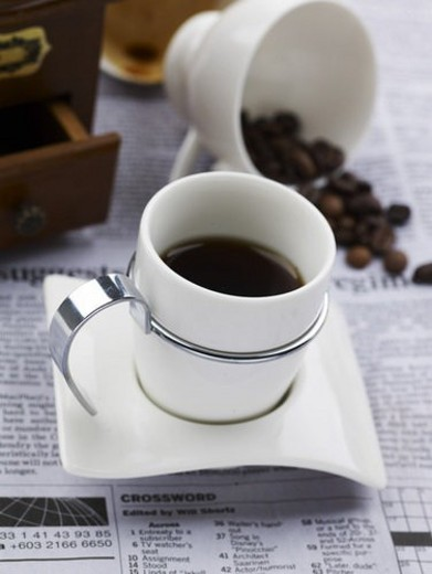 Stock Photo: 4029R-389384 food styling, saucer, coffee bean, newspaper, coffee grinder, decoration, coffee cup