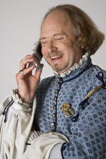 Stock Photo: 4029R-391444 William Shakespeare in period clothing talking on cell phone and laughing.