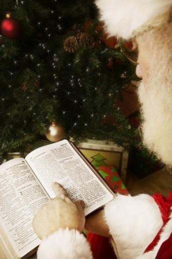 Stock Photo: 4029R-391661 Santa reading the Bible