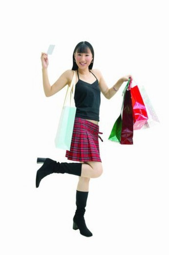 Shopping, Smiling, Indoor, Shopping Bag, Standing On One Leg, Lifestyles : Stock Photo
