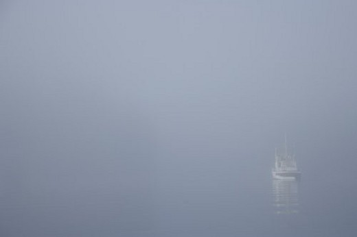 Stock Photo: 4029R-393805 Fishing boat in a fog