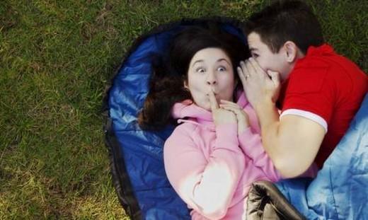 Couple telling a secret : Stock Photo