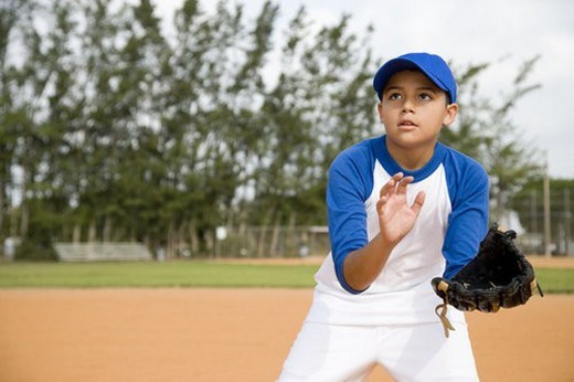 Boy trying to catch baseball : Stock Photo