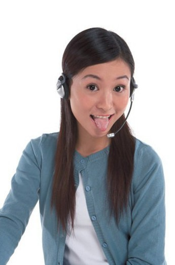 Young woman wearing headphone and making a face : Stock Photo
