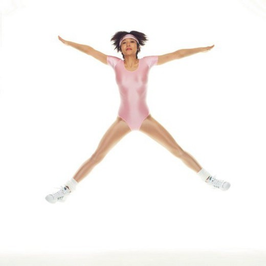 Stock Photo: 4029R-397505 A woman in Leotard Jumping, Front View