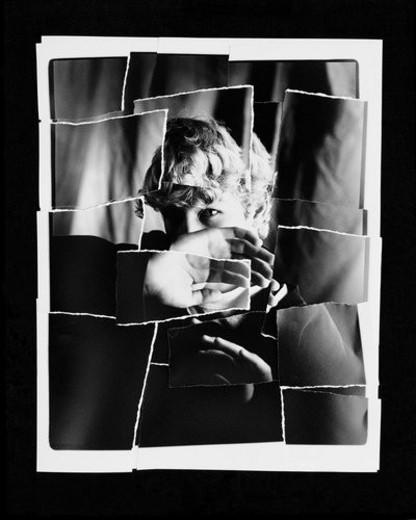 Stock Photo: 4029R-400657 Torn up photo of child blocking face with hand