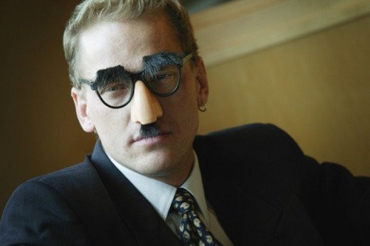 Stock Photo: 4029R-400668 Businessman wearing Groucho Marx disguise