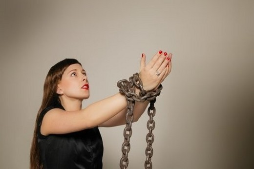 Woman wrapped in a chain : Stock Photo