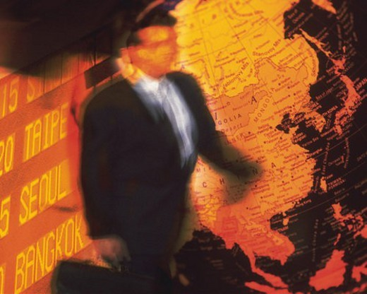 Businessman and image of globe and airline timetables, CG, composition, blurred motion, toned image : Stock Photo