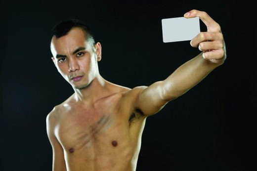 Bare Chest, Close-Up, Black Hair, Black Background, Asian Ethnicity : Stock Photo