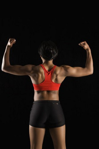 Stock Photo: 4029R-405120 Back view of muscular African American woman with biceps flexed.