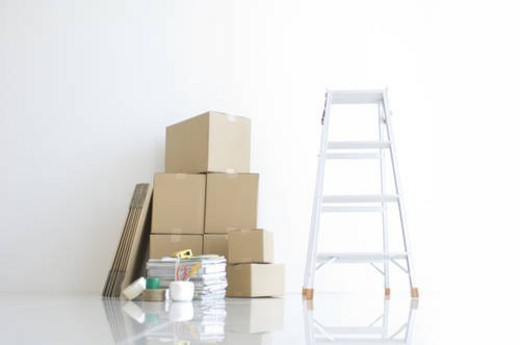 Stock Photo: 4029R-405358 Ladder and stack of cardboard boxes
