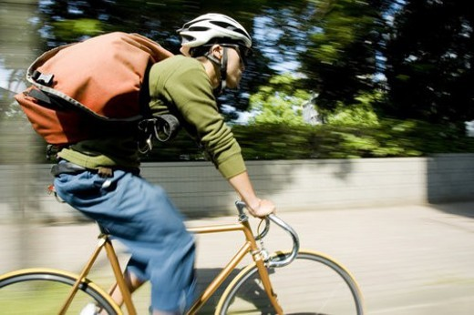 The Messenger Who Runs By A Bicycle All Over A Town : Stock Photo