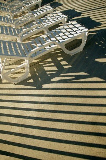 Chairs in the sun : Stock Photo