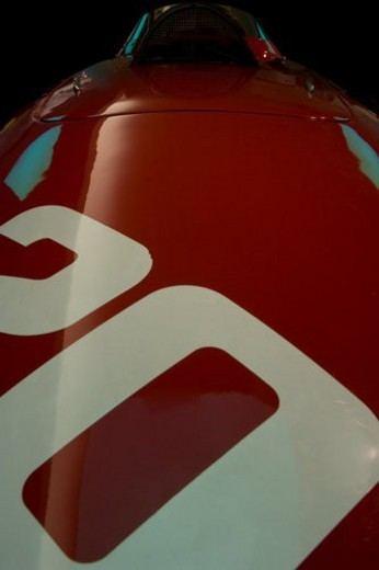 Detail of red Ferrari, race car, front view of hood and cockpit, with number 20 on hood : Stock Photo