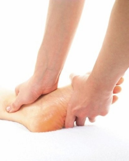 Stock Photo: 4029R-406860 Aesthetician Who Massages Bottom of Woman s Foot, Close Up