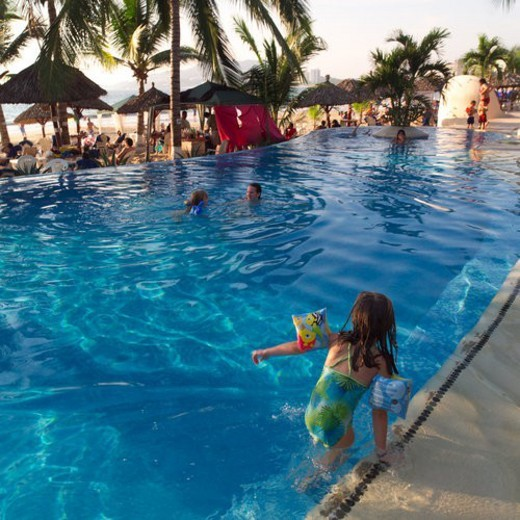 Stock Photo: 4029R-407092 Back view of a child entering a swimming pool