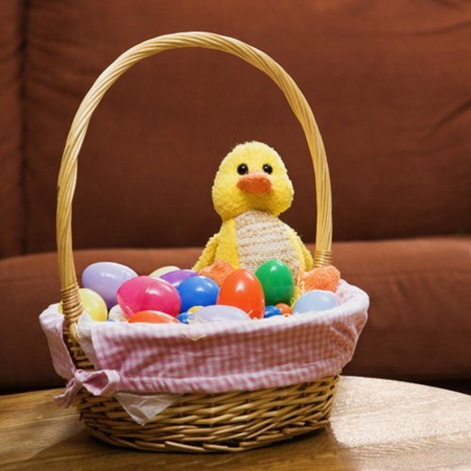 Stock Photo: 4029R-40710 Easter basket holding eggs and yellow duck.