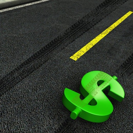 High angle view of a dollar sign on the road : Stock Photo