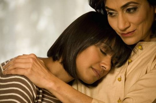 Stock Photo: 4029R-409521 Mother and daughter hugging