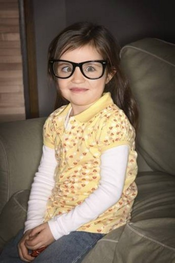 Stock Photo: 4029R-410372 A girl wearing glasses, crossing her eyes