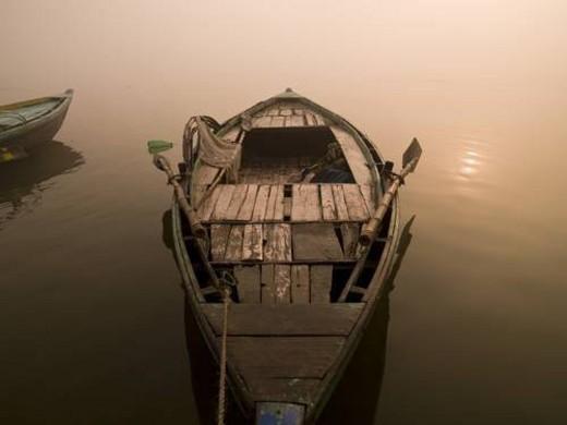 Stock Photo: 4029R-41109 Boat in the water, Varanasi, India