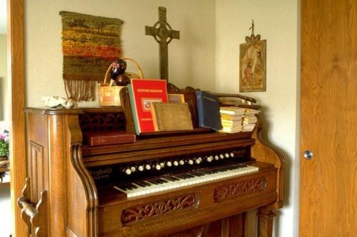Cross sitting on top of organ : Stock Photo