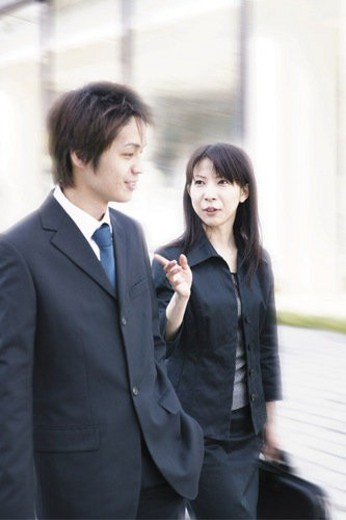 Stock Photo: 4029R-412326 A Business Man and A Business Woman