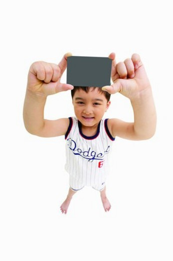 Stock Photo: 4029R-412629 Shorts, One Boy Only, Posing, 8-9 Years, Legs Apart, Human Hand