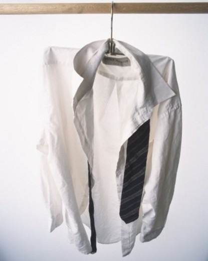 Shirt and tie hung at white wall : Stock Photo