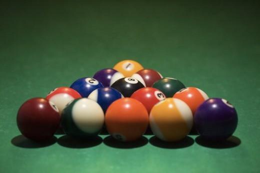 Rack of pool balls on green billiards table. : Stock Photo