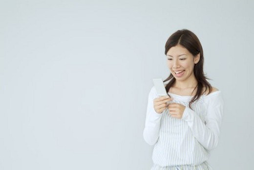 The Japanese Woman Who Does Pocket Mail : Stock Photo
