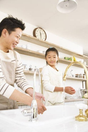 Stock Photo: 4029R-415687 Daughter helping her father in the kitchen