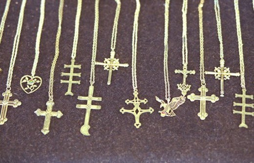 Stock Photo: 4029R-416162 Necklaces with crosses set out for sale at flea market