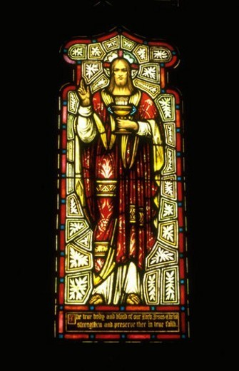 Jesus in red robe on stained glass window : Stock Photo