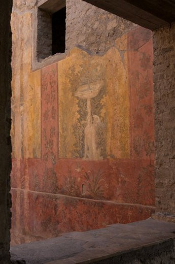 In the shadow of Vesuvius, the ruins of the Imperial Villa of Oplontis - detail of frescoes in guest rooms with architectural detail of window frame : Stock Photo