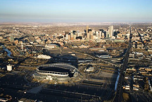 Stock Photo: 4029R-419981 Aerial cityscape of urban Denver, Colorado, with Mile High stadium in foreground.