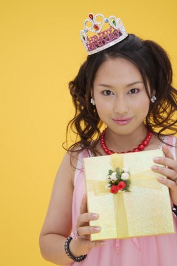 Stock Photo: 4029R-421643 Portrait of a teenage girl with a gift box
